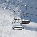Two chair lift with snowdrift in sun morning close up view caucasus mountains georgia ski resort gudauri Stock Photos
