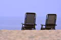 Two chair towards sea rest on sand shown as people talking personally and quite stay or spending holidy at beach Royalty Free Stock Images