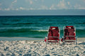 Two chairs on a beach with gulf of mexico background Royalty Free Stock Photography