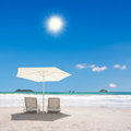 Two chairs at the beach and umbrella manuel antonio costa rica Royalty Free Stock Images