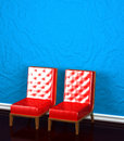 Two chairs near blue wall Stock Photos