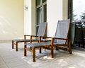 Two chaise longue on balcony empty and table of the hotel Stock Photos
