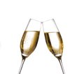 Two champagne flutes with golden bubbles make cheers on white background space for text Stock Photo