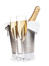 Two champagne glasses and bottle in bucket isolated on white small dof Stock Image