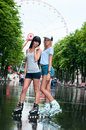 Two cheerful girls rollerblading Royalty Free Stock Photo