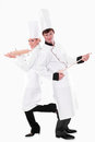 Two chefs with kitchen utensils Royalty Free Stock Photos