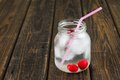 Two cherries in cold drink in a jar with pink straw horizontal photo of placed inside glass full of cool and ice cubes is too old Royalty Free Stock Photography