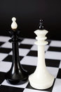 Two chess kings one in front of other. Fight of equal competitors Royalty Free Stock Photo