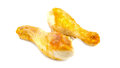 Two Chicken legs close-up isolated on a white Royalty Free Stock Photo