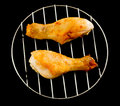 Two chicken legs on the grill top view on black Royalty Free Stock Photo
