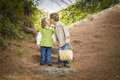 Two Children with Basket Kissing Outside on Steps Royalty Free Stock Photo