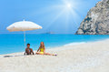 Two children on beach white near azure ionian sea egremni lefkada greece and sunshine Royalty Free Stock Photography
