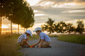 Two children, boy brothers, having fun outdoors with toy cars Royalty Free Stock Photo
