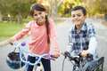 Two children on cycle ride in countryside smiling Stock Photography