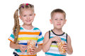 Two children eat popcorn Royalty Free Stock Photo