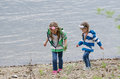 Two children that is going on the river bank Royalty Free Stock Photo