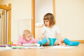 Two children in home together interior Royalty Free Stock Photo