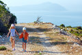 Two children and Lefkas cape Royalty Free Stock Image