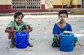 Two children in myanmar boy sitting for sell ice cream front of the temple myawaddy province Royalty Free Stock Photo