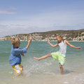 Two children playing in the sea Royalty Free Stock Photo