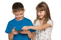 Two children playing smartphone white background Stock Photos
