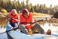 Two Children Rowing Kayak On Lake Royalty Free Stock Photo