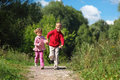 Two children run on path in summer Royalty Free Stock Photography