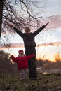 Two children on a sunset Royalty Free Stock Photo