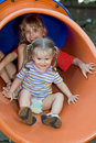 Two children on  waterslide. Stock Photo