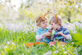 Two children wearing Easter bunny ears and eating chocolate Royalty Free Stock Photo