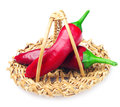 Two chili peppers in a basket Stock Image