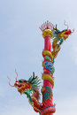 Two chinese dragons wrapped around red pole double style on the pillar to protect the land Stock Images