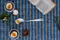 Two chocolate Easter eggs, spoon with yolk and shell next to Pra Royalty Free Stock Photo