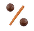 Two chocolates and cinnamon stick Royalty Free Stock Images