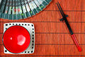 Two chopsticks on sushi mat and plates background Stock Image