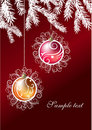 Two christmas balls hanging on a branch of fir Stock Photos