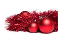 Two christmas tree toys with red garland over white background Stock Photos