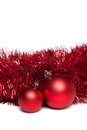 Two christmas tree toys with red garland over white background Royalty Free Stock Photography