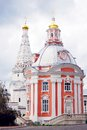 Two churches in Trinity Sergius Lavra decorated by golden crosses. Royalty Free Stock Photo