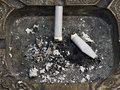 Two cigarette butts in an ashtray Royalty Free Stock Image