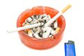 Two cigarettes and blue lighter on white Stock Photography