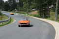 Two classic orange italian sports cars on road fiat spider at fiat freakout event in wintergreen virginia Royalty Free Stock Photos