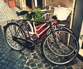 Two classic vintage retro city bicycles tinted photo rome italy Stock Photography