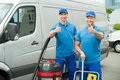 Two Cleaners Standing With Cleaning Equipments Royalty Free Stock Photo