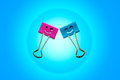 Two clip a pink a bluenclips like a pair of lovers Royalty Free Stock Photography
