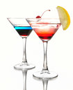 Two cocktail martini with a cherry on a white background Royalty Free Stock Photo