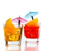 Two cocktail with orange slice and umbrella on top isolated on white background Royalty Free Stock Photo
