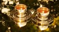 stock image of  Two coffee cups golden mirror image