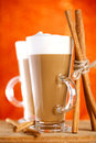 Two coffee latte with cinnamon sticks Royalty Free Stock Photos