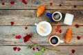 Two coffees, croissants, sugar, candy, yoghurt, rose and petals Royalty Free Stock Photo
